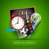 School supplies on blackboard - back to school concept Stock Photography