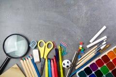 School supplies on blackboard Stock Photography