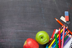 School supplies on blackboard background Royalty Free Stock Image