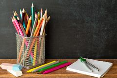 School supplies on blackboard background . The concept of education, study, learning, elearning. Back to schoolSchool supplies on. School supplies on blackboard royalty free stock image