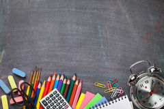 School supplies on blackboard background stock photo