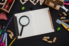 School Supplies on Blackboard Background with Open Notebook for Notes. Back to School Concept. Top view. royalty free stock photos