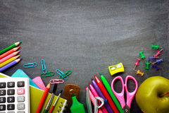 School supplies on blackboard background Stock Photos