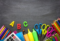 School supplies on blackboard background Stock Images