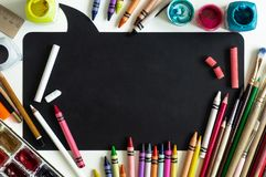 School board with school supplies on white background ready for your design. Back to school concept. Place for text royalty free stock image