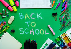 School supplies on blackboard background ready for your design Royalty Free Stock Photography