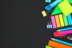 School supplies on blackboard background ready for your design. Flat lay. Top view. Copy space. School supplies on blackboard background ready for your design stock photos