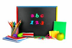School supplies and blackboard Royalty Free Stock Photos
