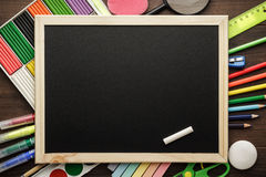 School supplies and blackboard Stock Image