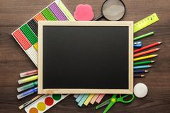 School supplies and blackboard Stock Photos