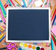 School supplies and blackboard Royalty Free Stock Photo