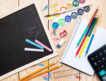 School supplies and blackboard Royalty Free Stock Photography