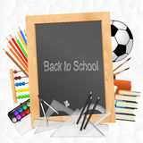 School supplies with blackboard Royalty Free Stock Image
