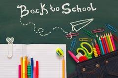 School supplies on blackboard with infographics. Back to school concept. School supplies on blackboard with infographics Stock Photography