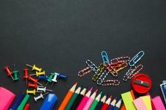 School supplies on blackboard Stock Image