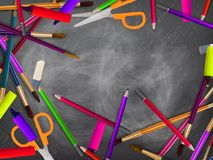 School supplies on blackboard. plus EPS10 Stock Photo