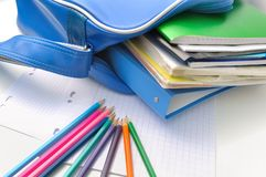 School supplies and book bag Stock Image