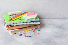 School supplies, books notebooks pencils on grey background with copy space.  royalty free stock photo
