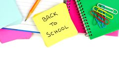 School supplies border with Back to School note pad Royalty Free Stock Photography