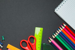 School supplies border on a chalkboard background Royalty Free Stock Photography