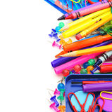 School supplies border. Border of colorful school supplies over white Royalty Free Stock Photo