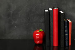 School supplies. With a bright red apple Royalty Free Stock Photo
