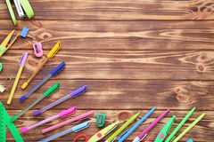 School supplies. On brown wooden table Royalty Free Stock Photo