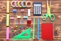 School supplies. On brown wooden table Royalty Free Stock Image