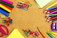 School supplies and bulletin board background. Colorful school supplies frame on a bulletin board Stock Images