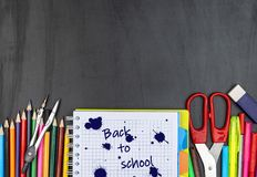 School supplies on chalk board. stock photos