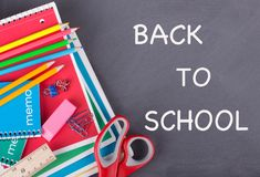 Back To School Supplies on a Chalkboard Royalty Free Stock Image