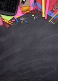 School Supplies on Chalkboard with Copy Space Royalty Free Stock Photography