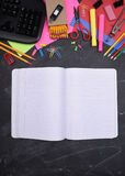 School Supplies on Chalkboard with Copy Space Stock Photography