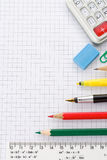 School supplies on checked background Stock Photos