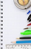 School supplies on checked background Royalty Free Stock Image