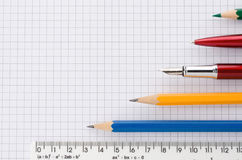 School supplies on checked background Stock Images