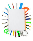 School supplies and checked notebook on white stock photography