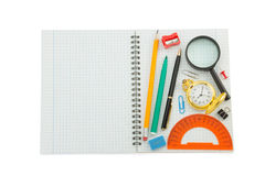 School supplies on checked notebook Royalty Free Stock Photography