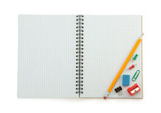 School supplies on checked notebook Royalty Free Stock Images