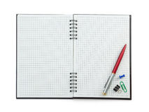 School supplies on checked notebook Royalty Free Stock Photo