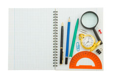 School supplies on checked notebook Stock Photos
