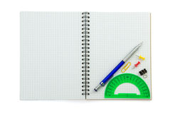 School supplies on checked notebook Stock Image