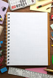 School supplies and checked notebook Royalty Free Stock Photos