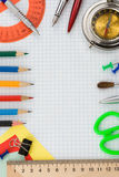 School supplies on checked paper stock photos