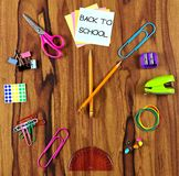 School supplies clock with Back to School note over wood Stock Photos