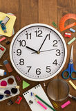 School supplies and clock on wood Royalty Free Stock Images