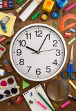 School supplies and clock on wood Royalty Free Stock Photo