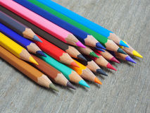 School supplies color pencils shavings  on wooden table Royalty Free Stock Images