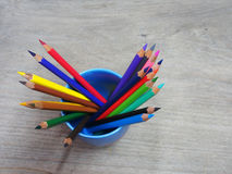 School supplies color pencils on wooden board Stock Photography