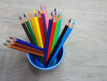 School supplies color pencils on wooden board Royalty Free Stock Photos